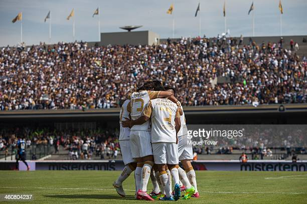 Martin Bravo and his teammates of Pumas de la UNAM celebrate a scored goal against Puebla during a match between Pumas UNAM and Puebla as part of the...