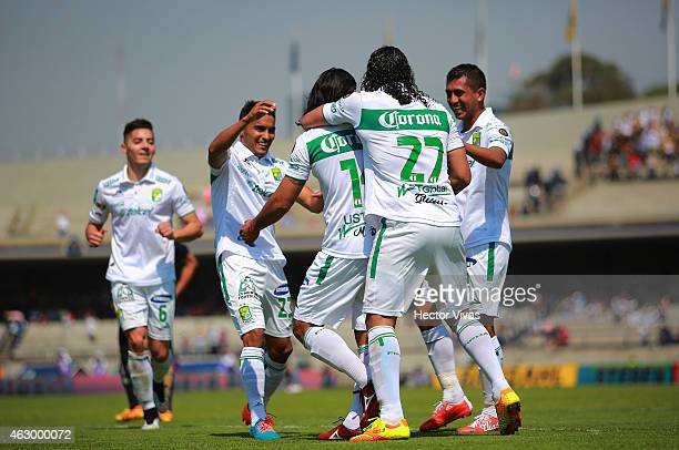 Martin Bravo of Leon celebrates with teammates after scoring the third goal of his team during a match between Pumas UNAM and Leon as part of 5th...