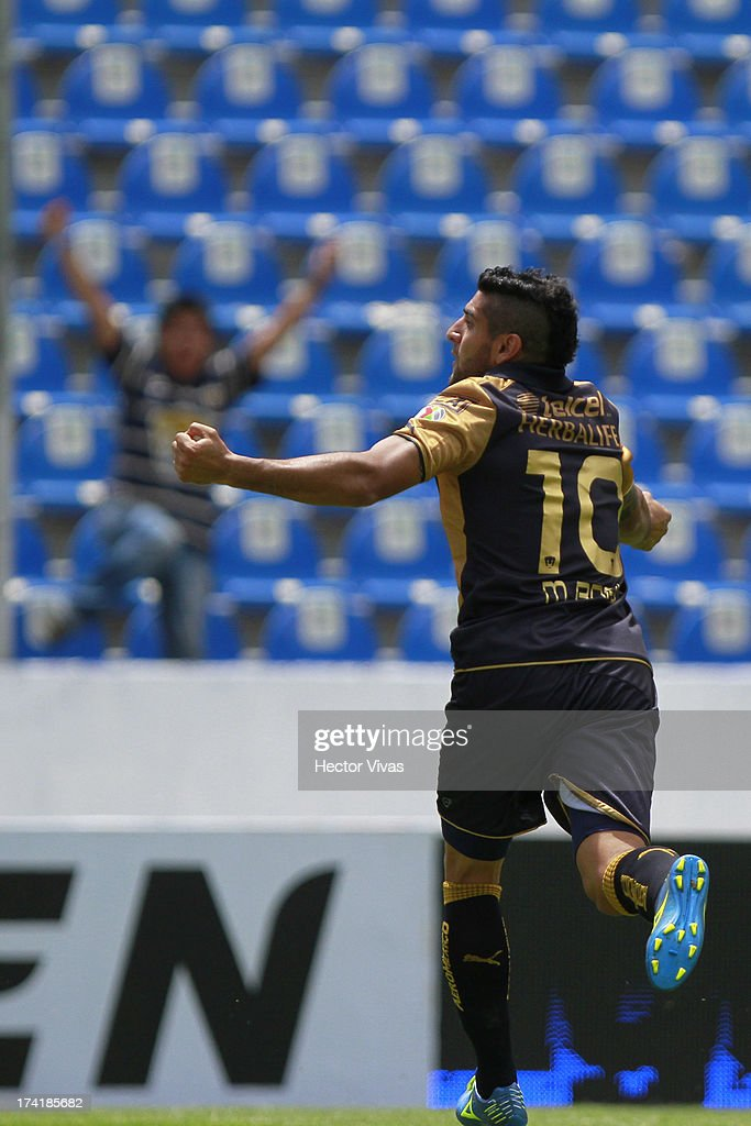 Martin Bravo of Pumas celebrates a goal against Puebla during a match between Pumas and Puebla as part of the Torneo Apertura 2013 Liga Mx at Cuauhtemoc Stadium on July 21, 2013 in Puebla, Mexico.