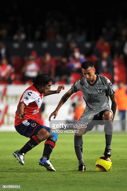 Martin Bravo of Veracruz vies for the ball with Leonel Vangioni of Monterrey during their Mexican Clausura tournament football match at the Luis...