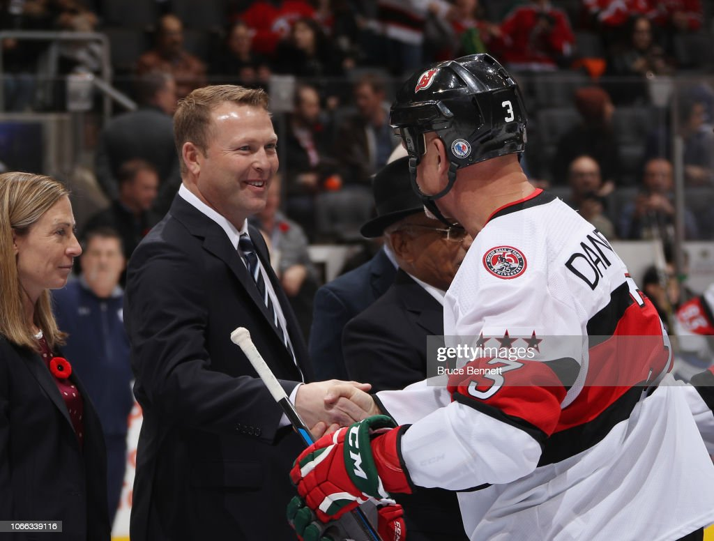 Martin Brodeur Is Congratulated By Ken Daneyko On His Hall Of Fame