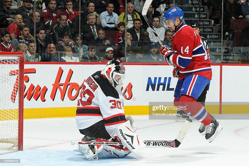 Martin Brodeur Makes A Save Against Tomas Plekanec Of The Montreal