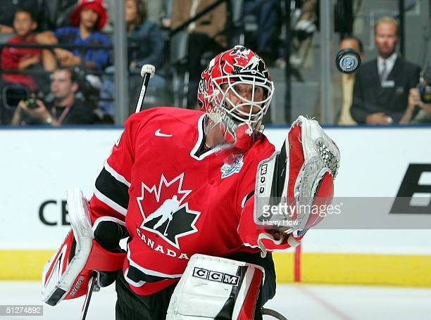 Martin Brodeur of Team Canada makes a glove save against Team Slovakia during the third period of the quarterfinal game in the World Cup of Hockey on...