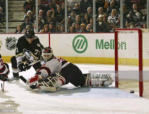 Martin Brodeur of the New Jersey Devils can't stop this third period goal by Evgeni Malkin of the Pittsburgh Penguins on October 24 2006 at the...