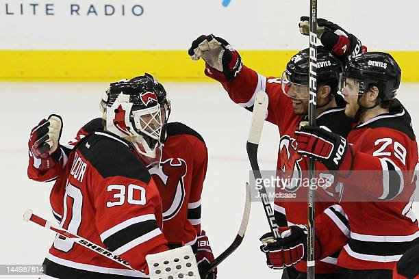 Martin Brodeur of the New Jersey Devils celebrates with his team after they defeated the New York Rangers 4 to 1 in Game Four of the Eastern...