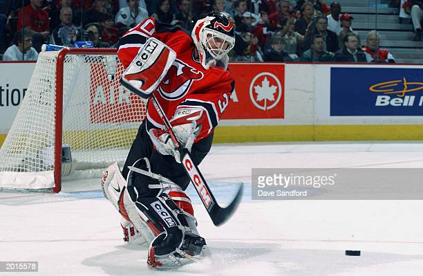 Martin Brodeur of the New Jersey Devils clears the puck out of the defensive zone against the Ottawa Senators in game two of the 2003 Eastern...