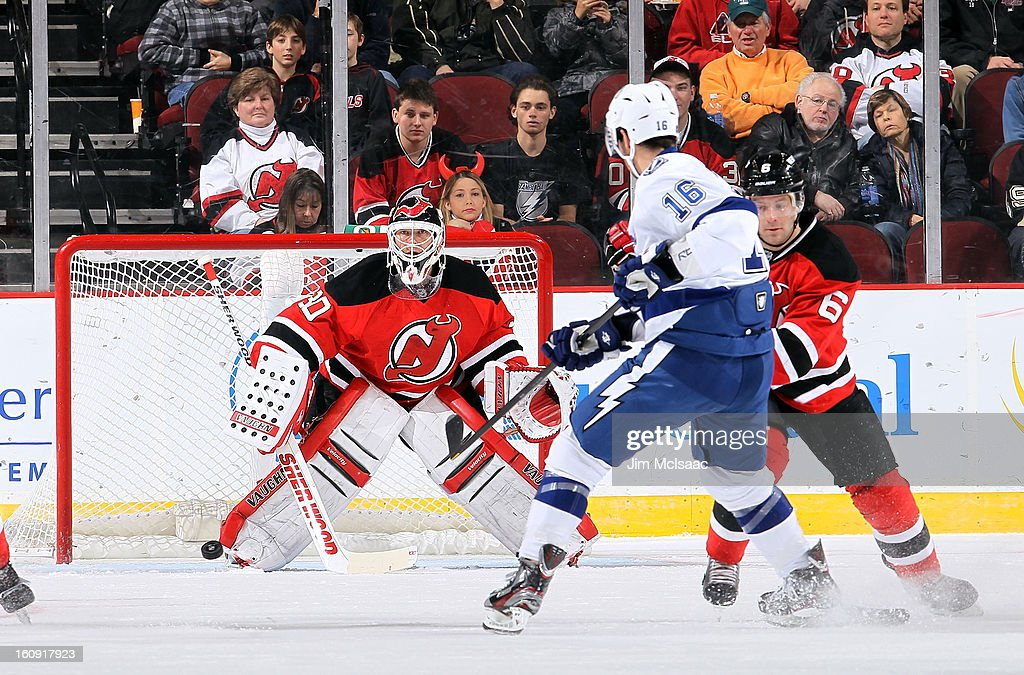 Martin Brodeur #30 of the New Jersey Devils defends a shot against Teddy Purcell #16 of the Tampa Bay Lightning at the Prudential Center on February 7, 2013 in Newark, New Jersey.
