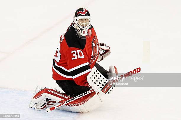 Martin Brodeur of the New Jersey Devils defends against the New York Rangers in Game Four of the Eastern Conference Final during the 2012 NHL Stanley...