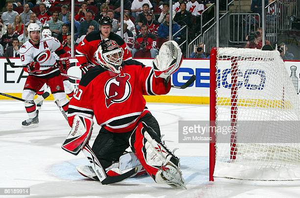 Martin Brodeur of the New Jersey Devils defends his net against the Carolina Hurricanes during Game Five of the Eastern Conference Quarterfinal Round...