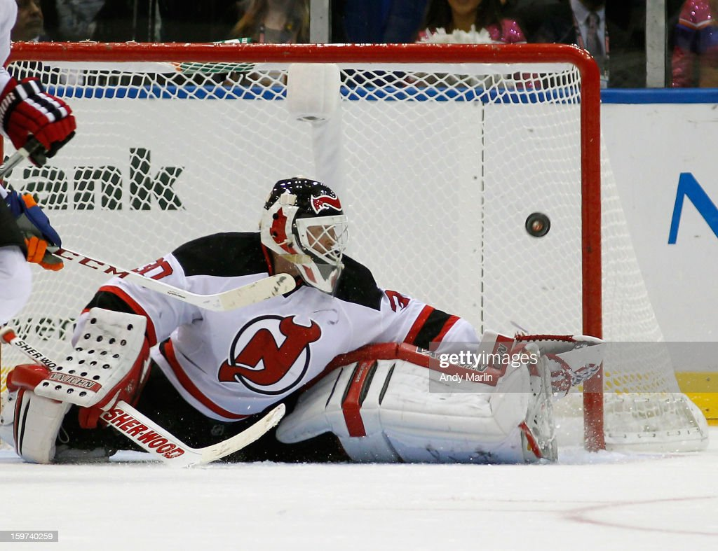 Martin Brodeur #30 of the New Jersey Devils eyes the puck after making a save against the New York Islanders during the Islanders home opener at the Nassau Coliseum on January 19, 2013 in Uniondale, New York.