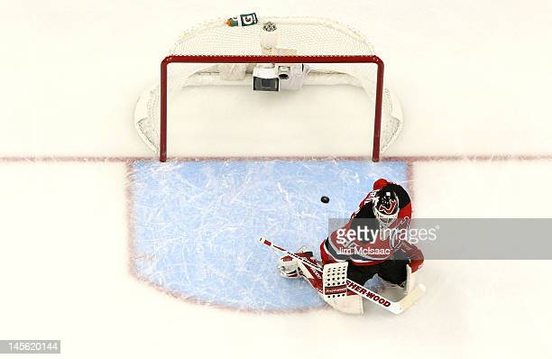 Martin Brodeur of the New Jersey Devils gives up a goal against Drew Doughty of the Los Angeles Kings in the first period during Game Two of the 2012...