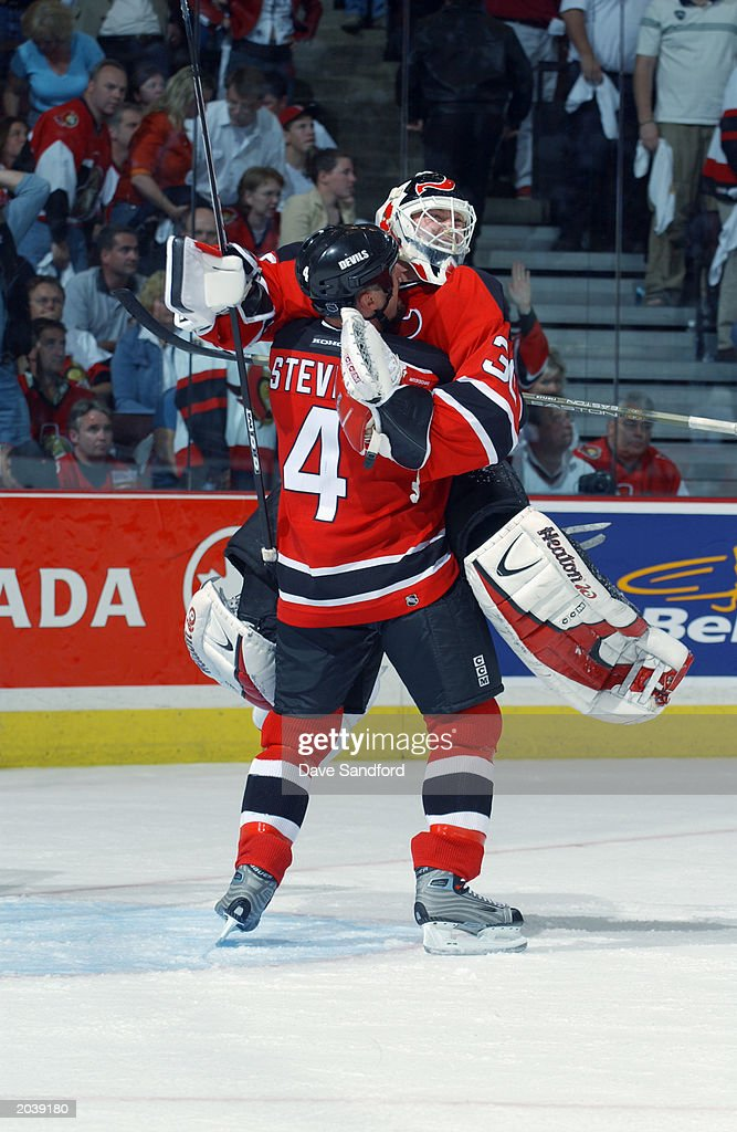 Brodeur leaps into Stevens arms after victory : News Photo