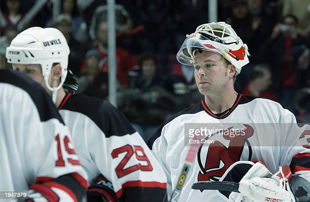Martin Brodeur of the New Jersey Devils linesup for the traditional end of a series hand shake against the Boston Bruins during game five of the...