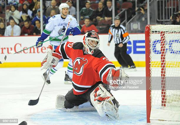 Martin Brodeur of the New Jersey Devils looks back after allowing a third period goal to Jannik Hansen of the Vancouver Canucks on December 2 2009 at...