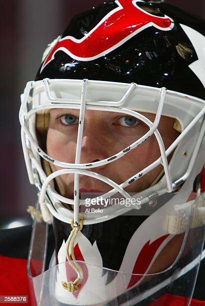 Martin Brodeur of the New Jersey Devils looks on before a game against the New York Rangers on October 3 2003 at Continental Airlines Arena in East...