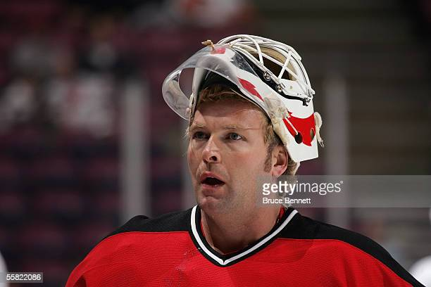 Martin Brodeur of the New Jersey Devils looks on during a preseason game against the New York Islanders at the Continental Airlines Arena on...