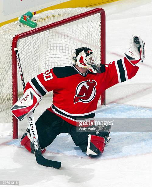 Martin Brodeur of the New Jersey Devils makes a glove save against the Atlanta Thrashers during their game at the Prudential Center on February 15,...