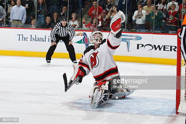 Martin Brodeur of the New Jersey Devils makes a glove save against the Minnesota Wild during the game at Xcel Energy Center on March 13, 2008 in...