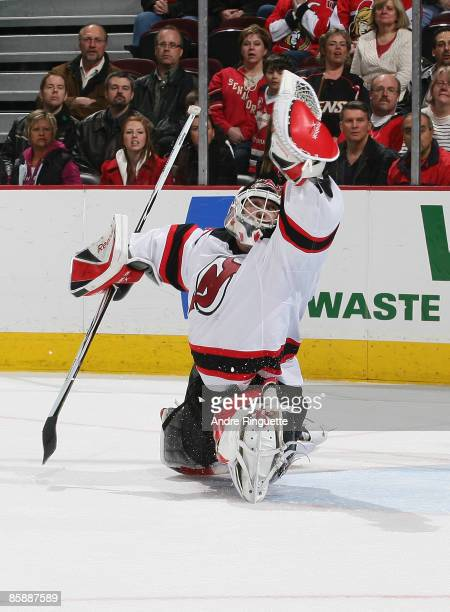 Martin Brodeur of the New Jersey Devils makes a glove save against the Ottawa Senators at Scotiabank Place on April 9 2009 in Ottawa Ontario Canada