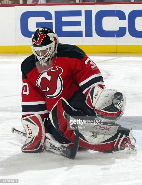 Martin Brodeur of the New Jersey Devils makes a glove save on his way to a shutout victory against the Philadelphia Flyers at the Prudential Center...
