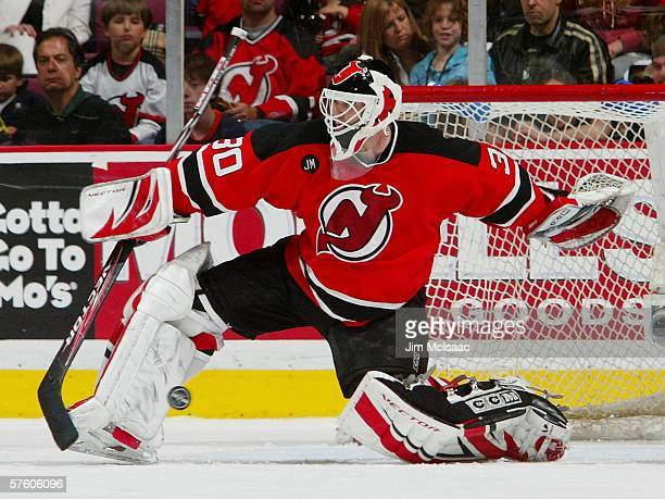 Martin Brodeur of the New Jersey Devils makes a save against the Carolina Hurricanes in game four of the Eastern Conference Semifinals during the...