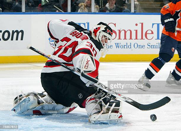 Martin Brodeur of the New Jersey Devils makes a save against the New York Islanders during their game on February 17, 2007 at Nassau Coliseum in...