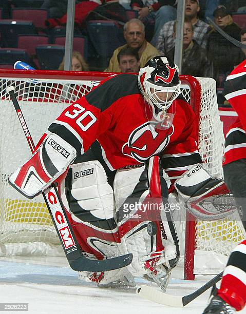 Martin Brodeur of the New Jersey Devils makes a save against the Ottawa Senators on February 3, 2004 at the Continental Airlines Arena in East...
