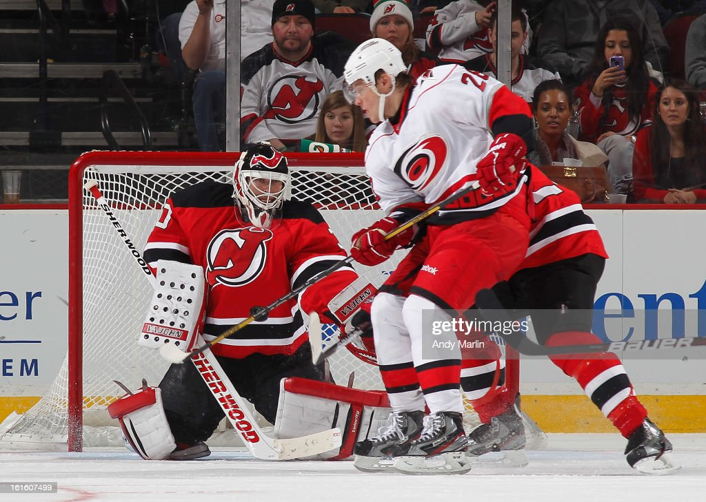 Martin Brodeur #30 of the New Jersey Devils makes a save as Alexander Semin #28 of the Carolina Hurricanes looks for a rebound during the game at the Prudential Center on February 12, 2013 in Newark, New Jersey.