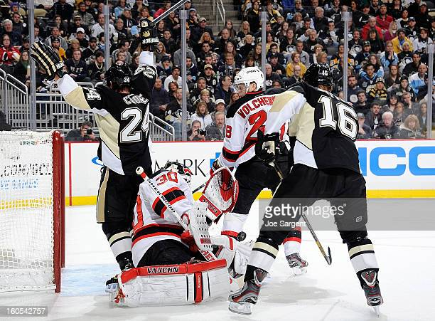 Martin Brodeur of the New Jersey Devils makes a save in front of Matt Cooke and Brandon Sutter of the Pittsburgh Penguins on February 2 2013 at...