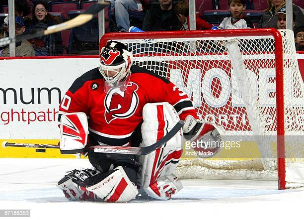 Martin Brodeur of the New Jersey Devils makes a stick save against of the Toronto Maple Leafs during their game at the Continental Airlines Arena on...