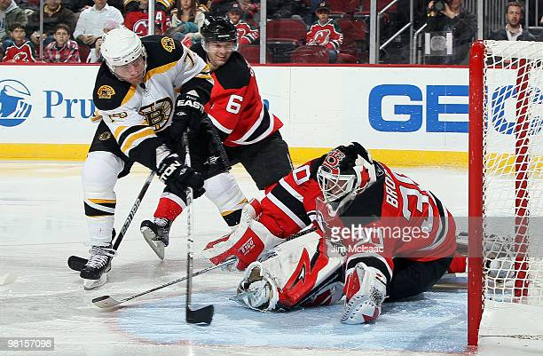 Martin Brodeur of the New Jersey Devils makes a third period save against Michael Ryder of the Boston Bruins at the Prudential Center on March 30,...