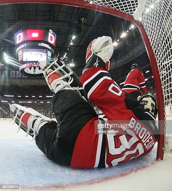 Martin Brodeur of the New Jersey Devils makes the save against the Carolina Hurricanes during Game Seven of the Eastern Conference Semifinal Round of...