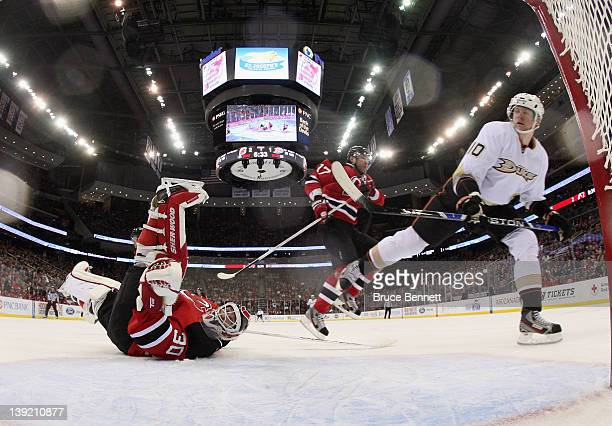 Martin Brodeur of the New Jersey Devils makes the save on Corey Perry of the Anaheim Ducks at the Prudential Center on February 17 2012 in Newark New...