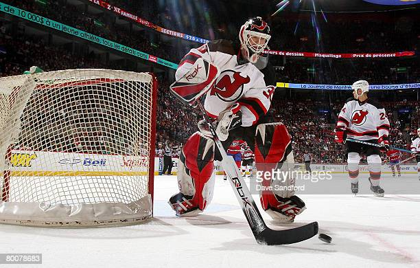 Martin Brodeur of the New Jersey Devils plays the puck against the Montreal Canadiens during their NHL game at the Bell Centre March 1, 2008 in...