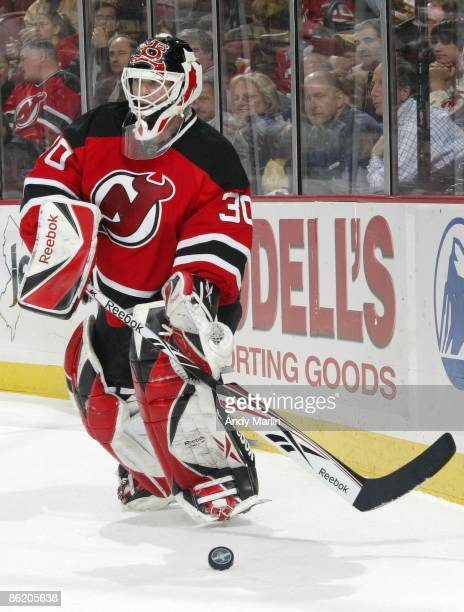 Martin Brodeur of the New Jersey Devils plays the puck on his way to his 23rd playoff shutout tying him with Patrick Roy for number one all time in...