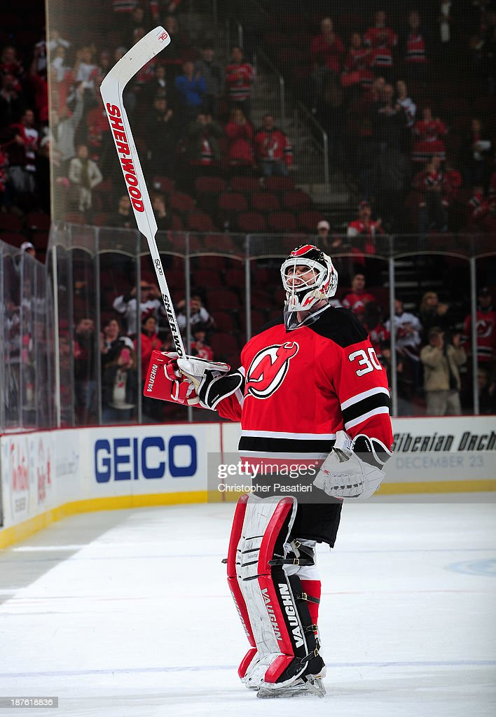 Martin Brodeur #30 of the New Jersey Devils salutes the crowd after being named the second star of the game for shutting out the Nashville Predators 5-0 on November 10, 2013 at the Prudential Center in Newark, New Jersey.