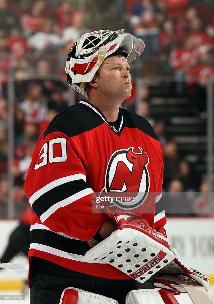 Martin Brodeur #30 of the New Jersey Devils skates back to the net during a stop in play against the New York Islanders at the Prudential Center on January 31, 2013 in Newark, New Jersey.