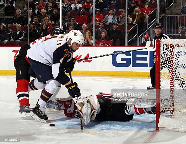 Martin Brodeur of the New Jersey Devils stops Zach Bogosian of the Atlanta Thrashers during the first period at the Prudential Center on March 15...