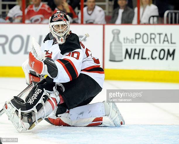 Martin Brodeur of the New Jersey Devils watches a shot go wide of the net against the Carolina Hurricanes during Game Four of the Eastern Conference...