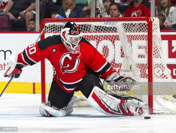 Martin Brodeur of the New Jersey Devils watches the puck after making a pad save against the Carolina Hurricanes in game four of the Eastern...