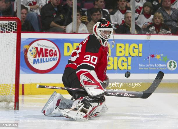 Martin Brodeur of the New Jersey Devils watches the puck after making a blocker save against the Carolina Hurricanes in game four of the Eastern...