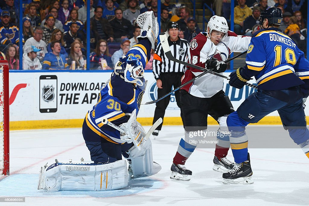 Martin Brodeur Of The St Louis Blues Makes A Save Against Daniel