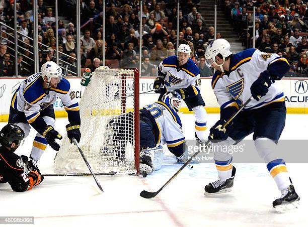 Martin Brodeur of the St Louis Blues makes a save on a wrap around by Kyle Palmieri of the Anaheim Ducks as Alex Pietrangelo Jay Bouwmeester and...