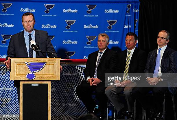 Martin Brodeur of the St Louis Blues talks with the media as Brett Hull Bernie Federko and Al MacInnis look on at a press conference to announce his...