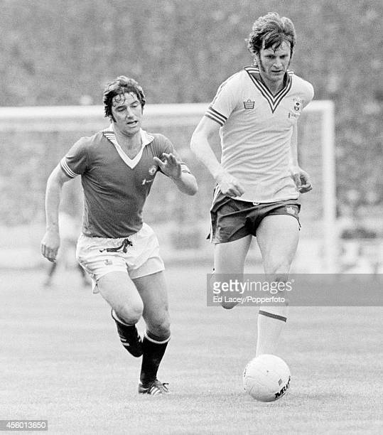 Martin Buchan of Manchester United chases Mick Channon of Southampton during the FA Cup Final at Wembley Stadium in London on 1st May 1976....