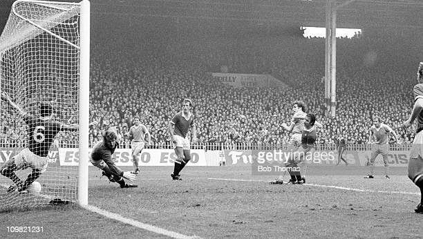 Martin Buchan of Manchester United clears the ball off the line with goalkeeper Alex Stepney beaten during their Division One match against...
