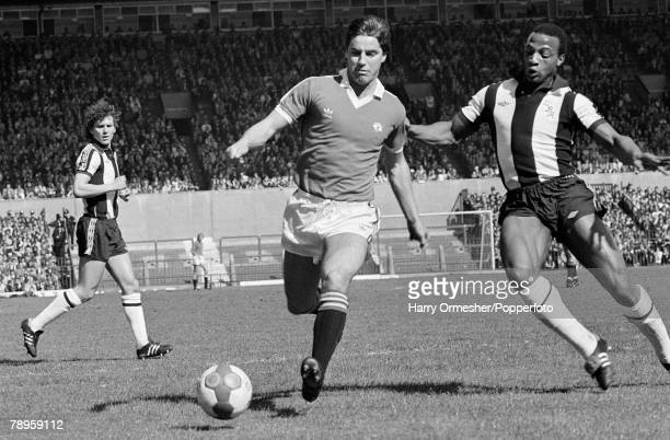 18th April 1981 Old Trafford Manchester Manchester United 2 v West Bromwich Albion 1 Manchester United's Martin Buchan tries to escape from West...