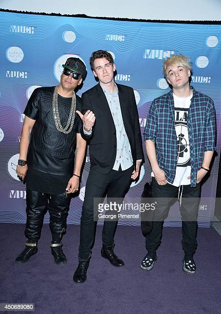 Martin Bucky Seja Patrick Pat Gillett and Cameron Camm Hunter of Down With Webster pose in the press room at the 2014 MuchMusic Video Awards at...