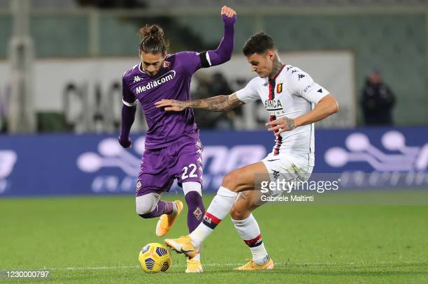 Martin Caceres of ACF Fiorentina battles for the ball with Gianluca Scamacca of Genoa CFC during the Serie A match between ACF Fiorentina and Genoa...