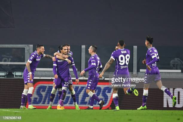 Martin Caceres of Fiorentina celebrates with teammates after scoring their team's third goal during the Serie A match between Juventus and ACF...